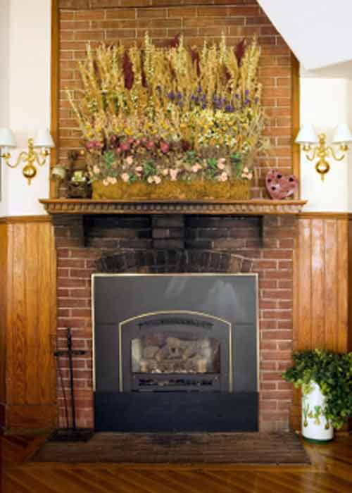 Brick Fireplace Pictures; Creative Artistic Mantel Flower Decoration on Brick Fireplace